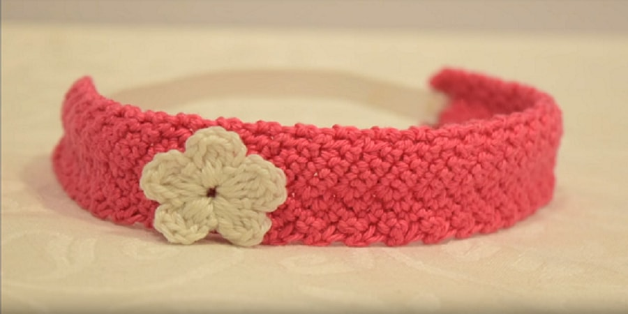 It's easy to make cute adorable Crochet Headband with flower. Make it in less than an hour! Perfect DIY gift idea for a baby shower, birthday or Christmas.