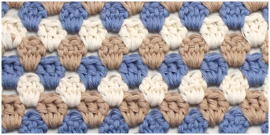 """Learn how to crochet the quirky and colourful """"Crochet Granny Stripe Stitch"""" with this easy to follow video tutorial. One of the first projects most crocheters will ever venture to attempt crocheting is the Granny Square. Enjoy, guys !"""